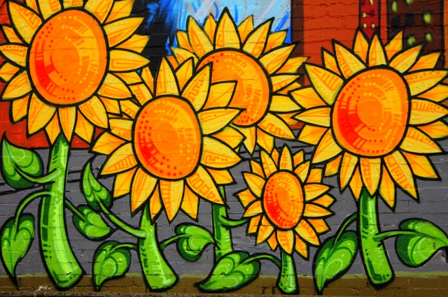 grow and resist north park grocery seattle mural sunflower