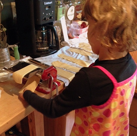 Starting her young. Kids love making pasta!